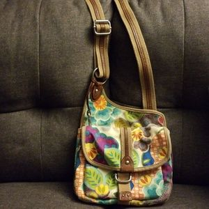 Beige Fossil bag with multi-colored flowers